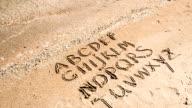English alphabet written on a beach sand. video