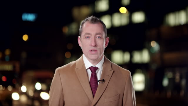 English male reporter reporting live to the studio from the city center video