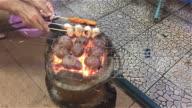 Enjoy grilling hot dog,meat balls and potatoes. video