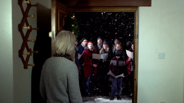 Enjoying Christmas Carol Singers from the House front door video