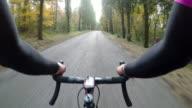 Enjoying the autumn season in Tuscany on bicycle. POV video