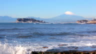 Enoshima Island with waves, Mt Fuji in background video