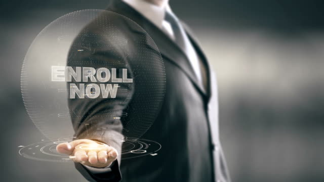 Enroll Now Businessman Holding in Hand New technologies video