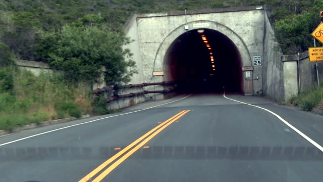 Entering One-Way Tunnel Viewed Through Dirty Windshield With Reflections video