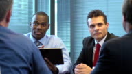 Enthusiastic Professionals Use Digital Tablet in Meeting video