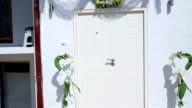 Entrance door decorated for wedding video