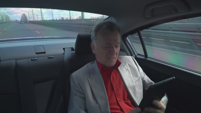 Entrepreneur drive on the work by car in taxi video
