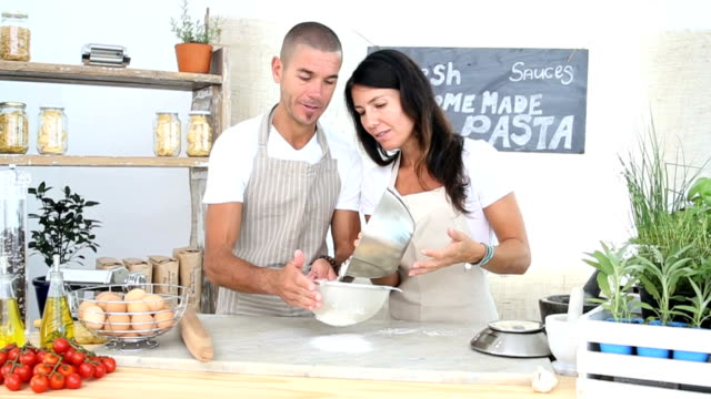 Entrepreneurs Sifting flour at the organic market stall video