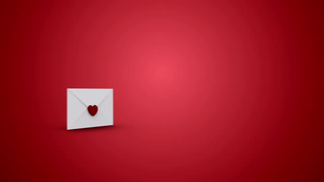 Envelope opening to reveal valentines message with love hearts video