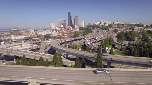 Epic Aerial Flight Over Commuter Cars on Interstate Freeway with Skyline of Downtown Seattle Skyscraper Buildings video