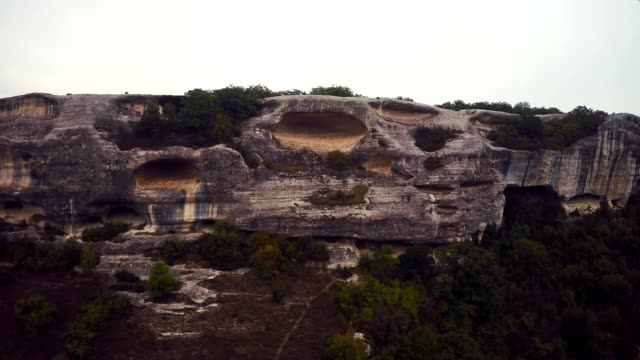 Epic Aerial view of Eski-Kermen. The ruins of the ancient city Mangup Kale. Cloudy sky evening. Mountain Mangup, Crimea. video