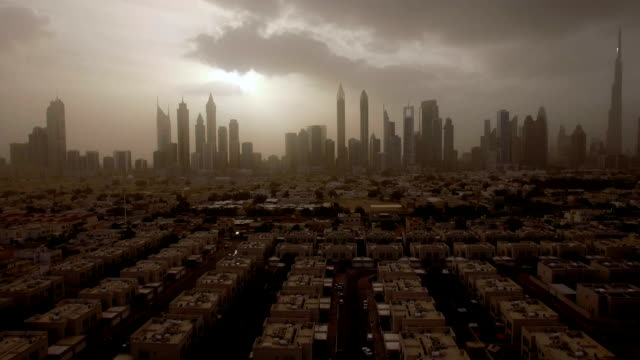epic aerial view of the urban landscape, with large skyscrapers and the sun breaking through the clouds. Dubai, UAE video