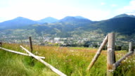 Epic Mountain Carpathian landscape and old wooden fence in the foreground video