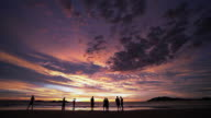 Epic tropical sunset with people video