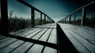 Epic wooden bridge in mountains horizontal dolly shot. Close up video