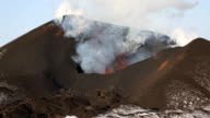 Eruption active volcano - effusion from crater: lava, gas, steam, ash. Kamchatka video