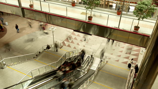 Escolator on railway station, people motion. Slider, time-lapse shot video