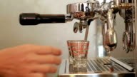 2 espresso shots getting brewed into shot glasses video