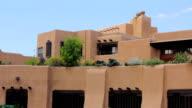 Establishing shot of a lavish adobe holiday villa with a rooftop garden. video