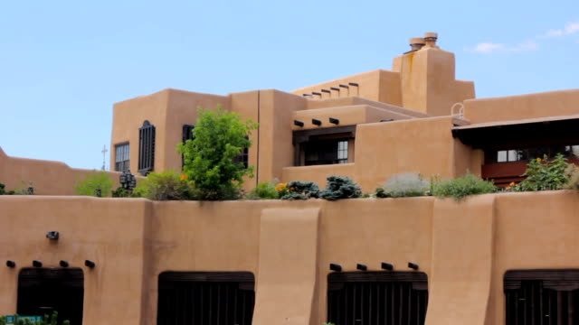 Establishing shot of a lavish adobe holiday villa with a rooftop garden. video