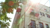 Establishing shot of an apartment building with fire escapes video