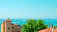 Establishing shot of typical spanish apartment building and sea view, Tarragona, Spain video