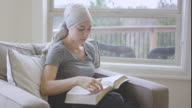 Ethnic adult female cancer patient reading the bible video