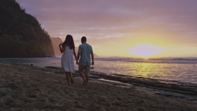 Ethnic couple walking up tropical beach video