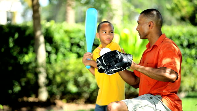 Ethnic Father & Son Practicing Baseball video