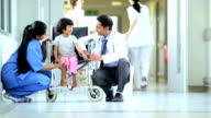 Ethnic Female Child Comforted Asian Indian Nurse Doctor Before Treatment video