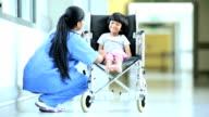 Ethnic Female Nurse Reassuring Young Child Patient video
