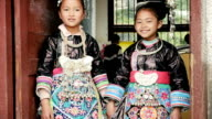 Ethnic minority (Dong) school girls in traditional clothing in China video
