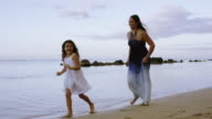 Ethnic Mother and Daughter Walking on Beach video