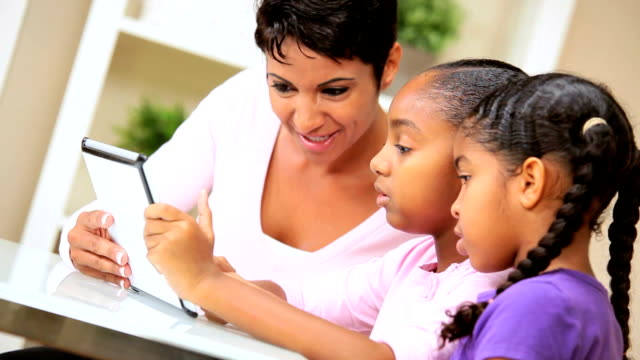 Ethnic Mother and Daughters Using Wireless Tablet video