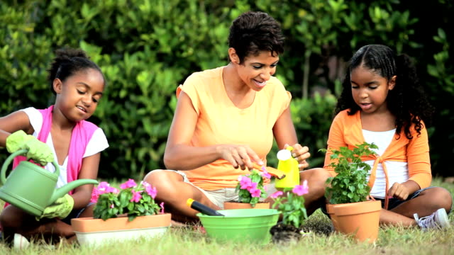 Ethnic Mother & Daughters Gardening Together video