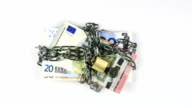 Euro banknotes in chains video