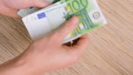 Euro banknotes on table video
