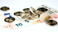Euro coins falling down video