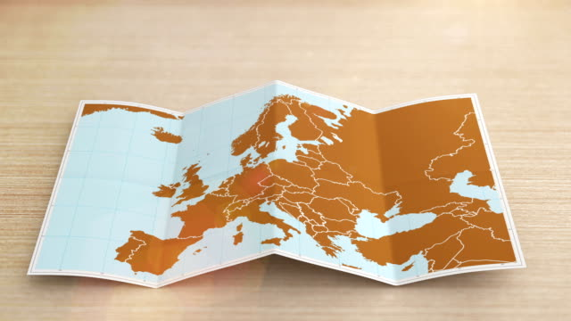 Europe map folds out on desk. Three in one. video