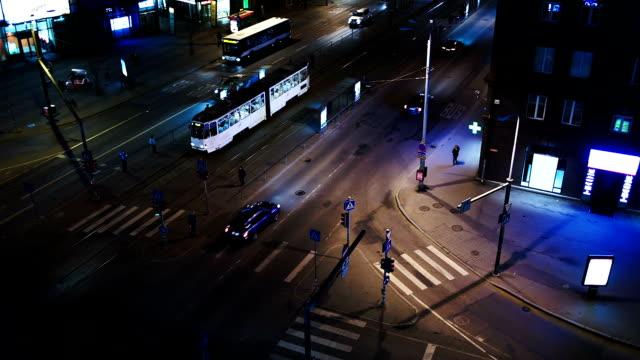 Evening city traffic in Tallin, Estonia. Crossroad with public transport video