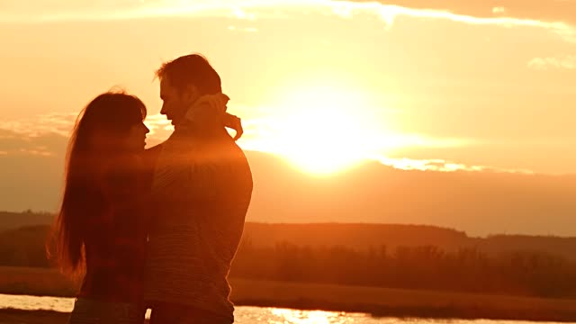 evening loving couple embracing at sunset slow motion video video
