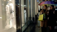 Evening shopping in rainy city video