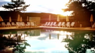 Evening sun shineson  open air pool in a luxurious resort video