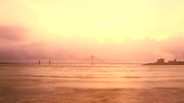 Evening to night time lapse shot of Bandra- Worli sea link (bridge) over the Arabian sea with the cloud formation and changing skyline in the background, Mumbai, india video