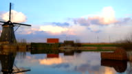 Evening view of windmill and water reflection video