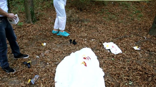 Evidence examining on murder scene video