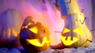 Evil pumpkin in night light glow, vapor or mist flowing around. Traditional attributes of the All Saints' Day or Halloween video