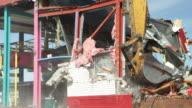 Excavator Demolishing a Building Wall video