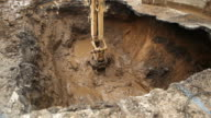 Excavator Digging for a Broken Water Main Below Street video