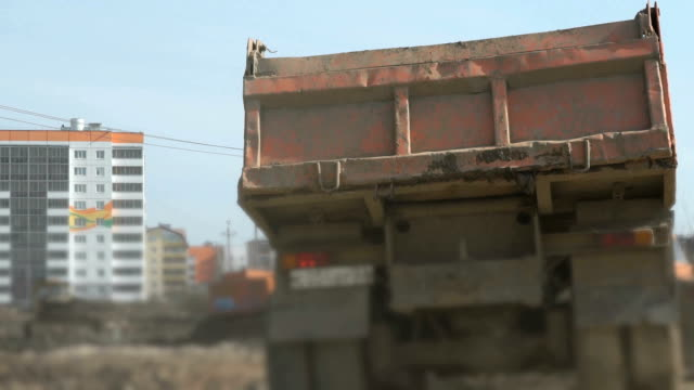 Excavator loads the clay into the trucks video